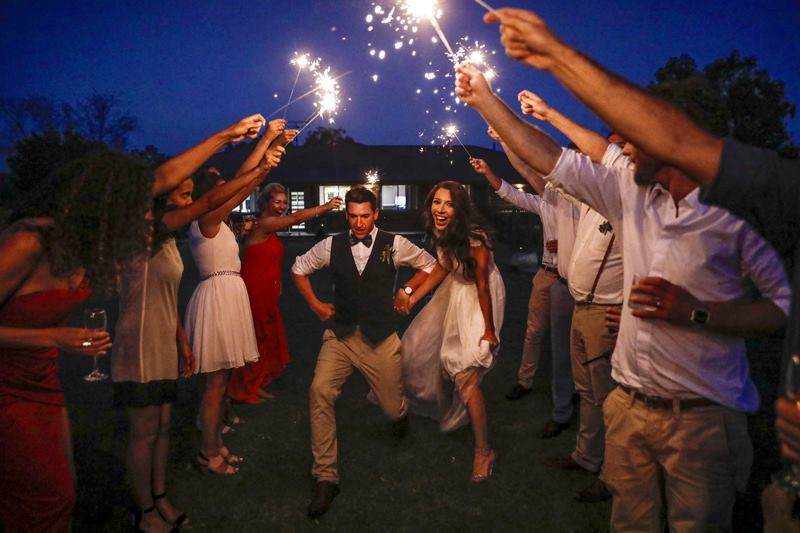 Bride and Groom Having Fun With Sparklers