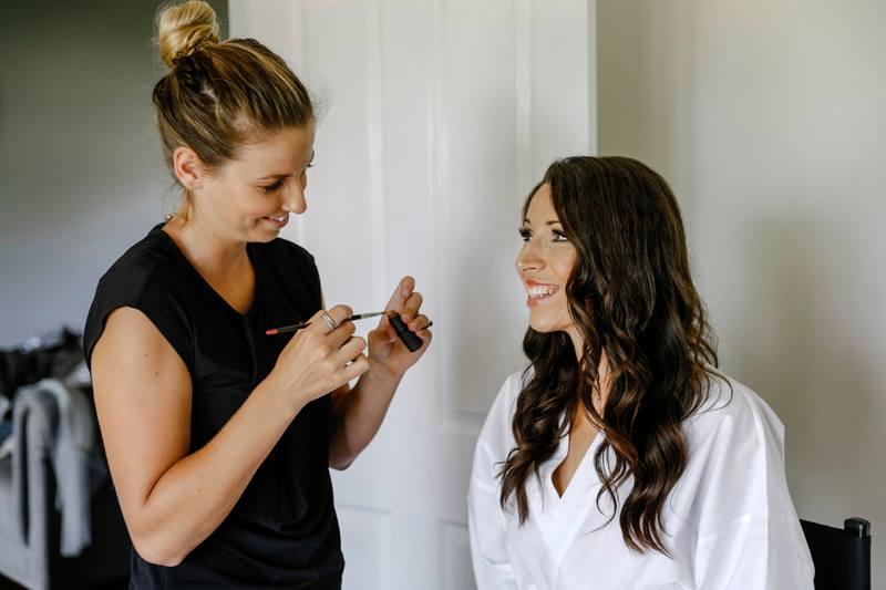 Bride having make up done before wedding