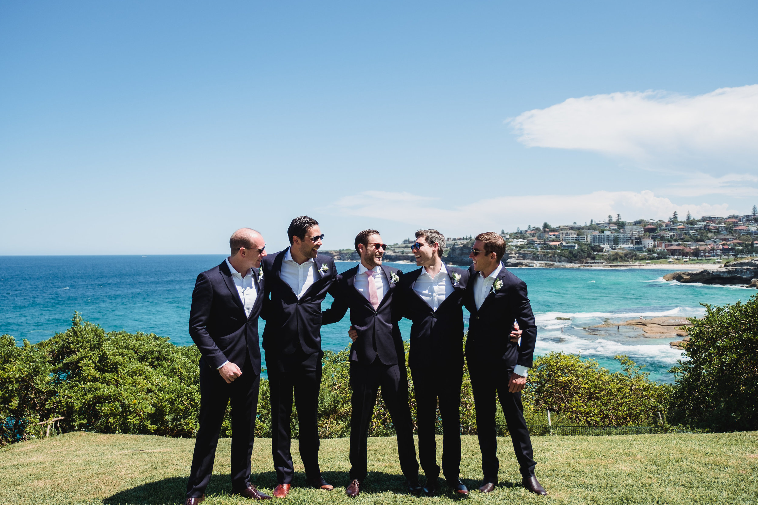 Grooms taking a group photo before the wedding in Bondi Beach