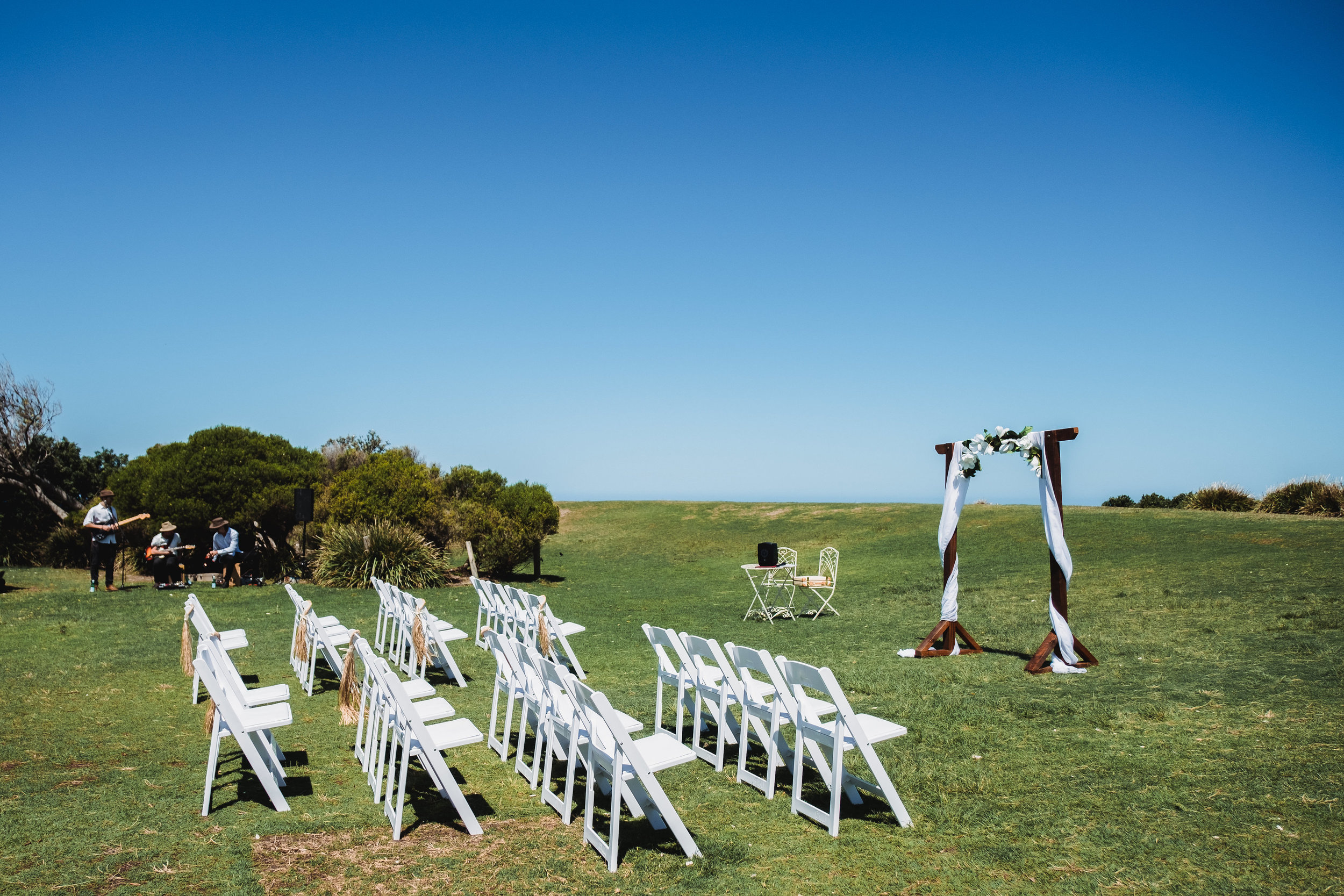 Wedding Ceremony set up with white chairs at Marks Park in Bondi Beach