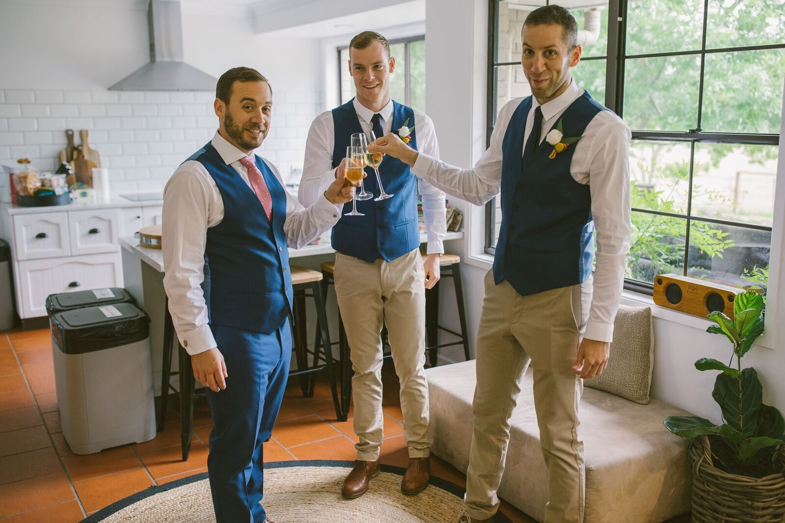Grooms drinking champagne and saying cheers before the wedding