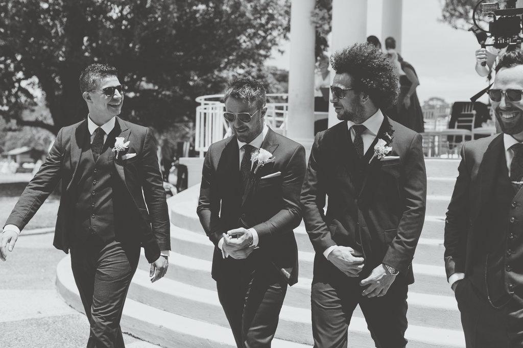 James Knibbs Groom and his Groomsmen walking at Balmoral Rotunda before the wedding ceremony