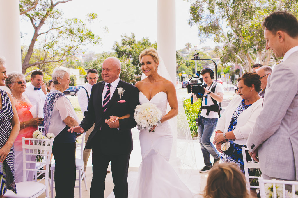 Bride Natalie Lowe and her father walking down the aisle at Balmoral Rotunda Wedding Ceremony