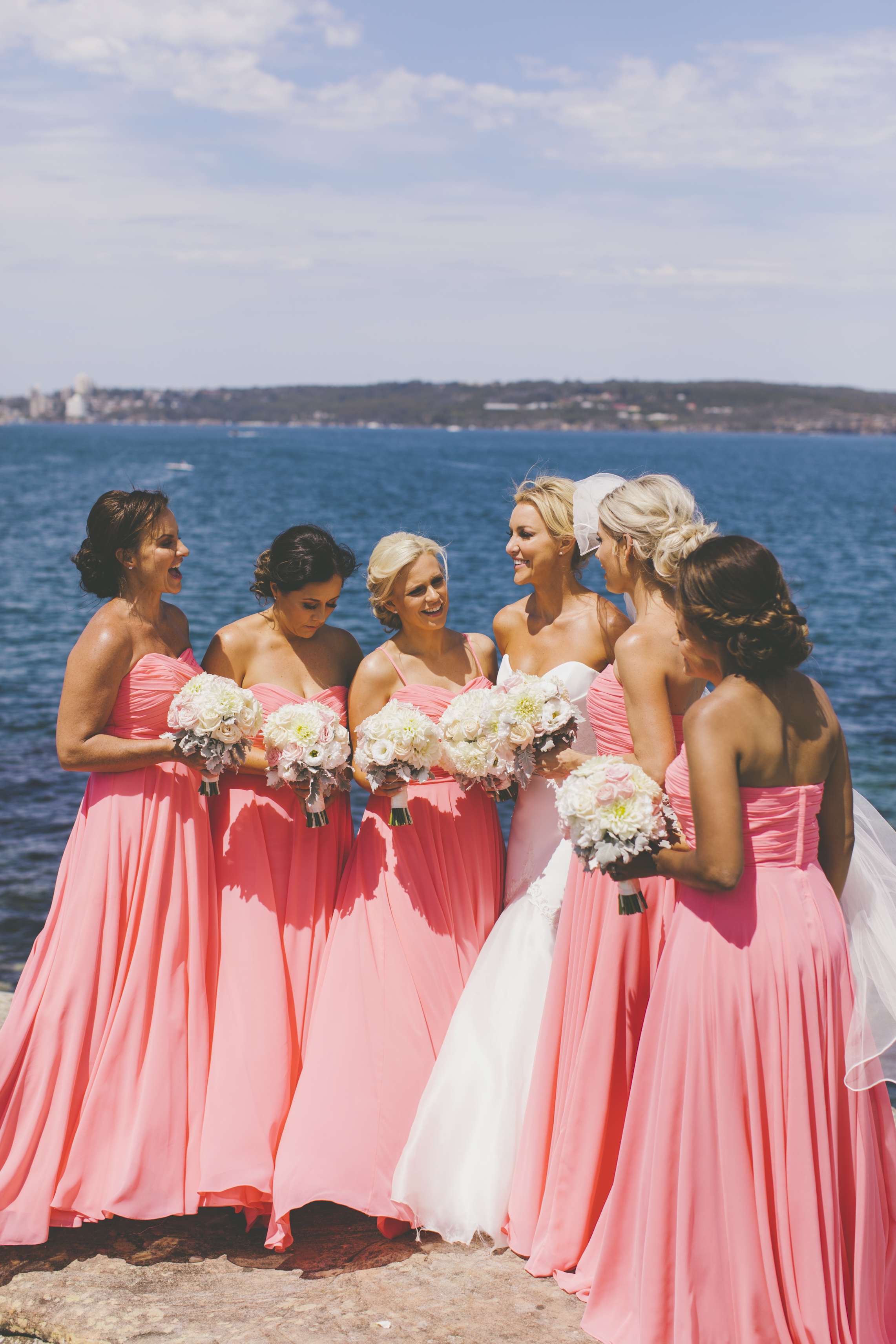 Bride and Bridesmaids on the rocks at Balmoral Beach