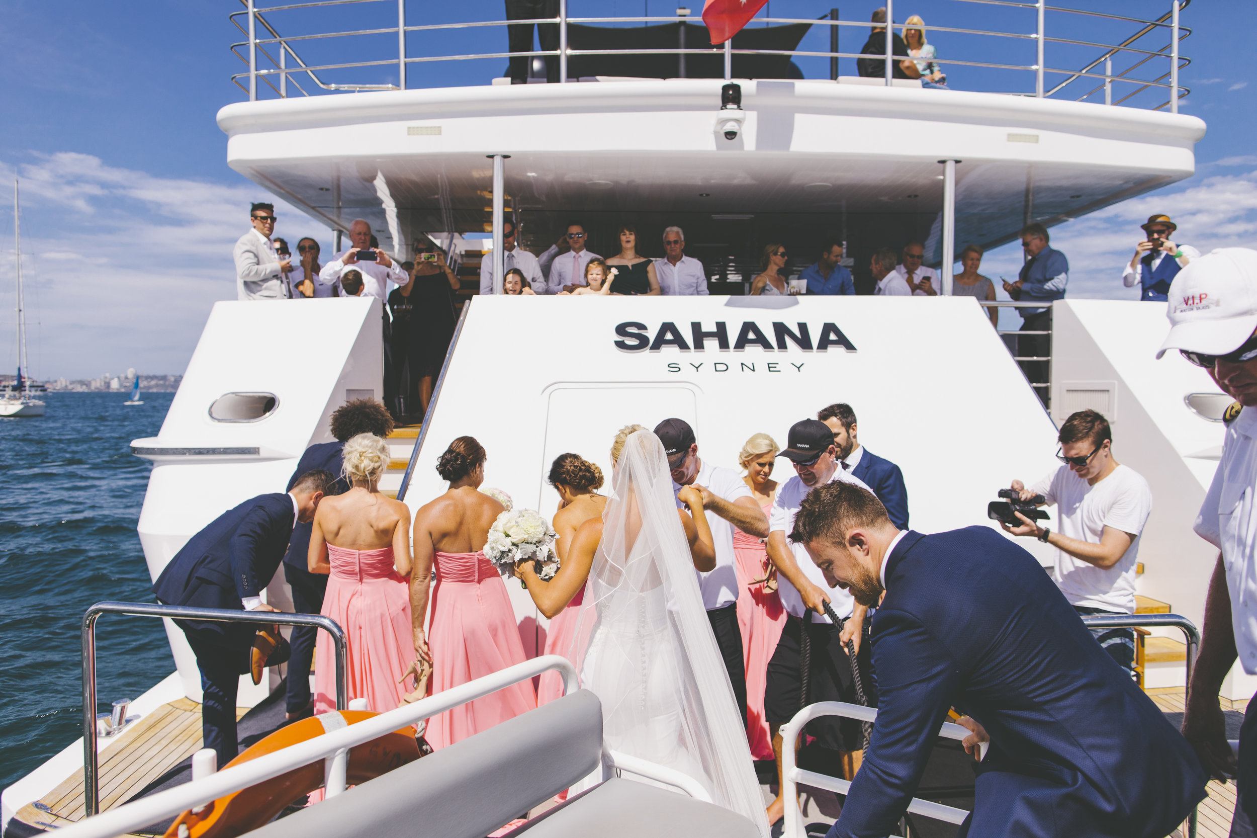Bride and Groom getting on the boat at their wedding reception