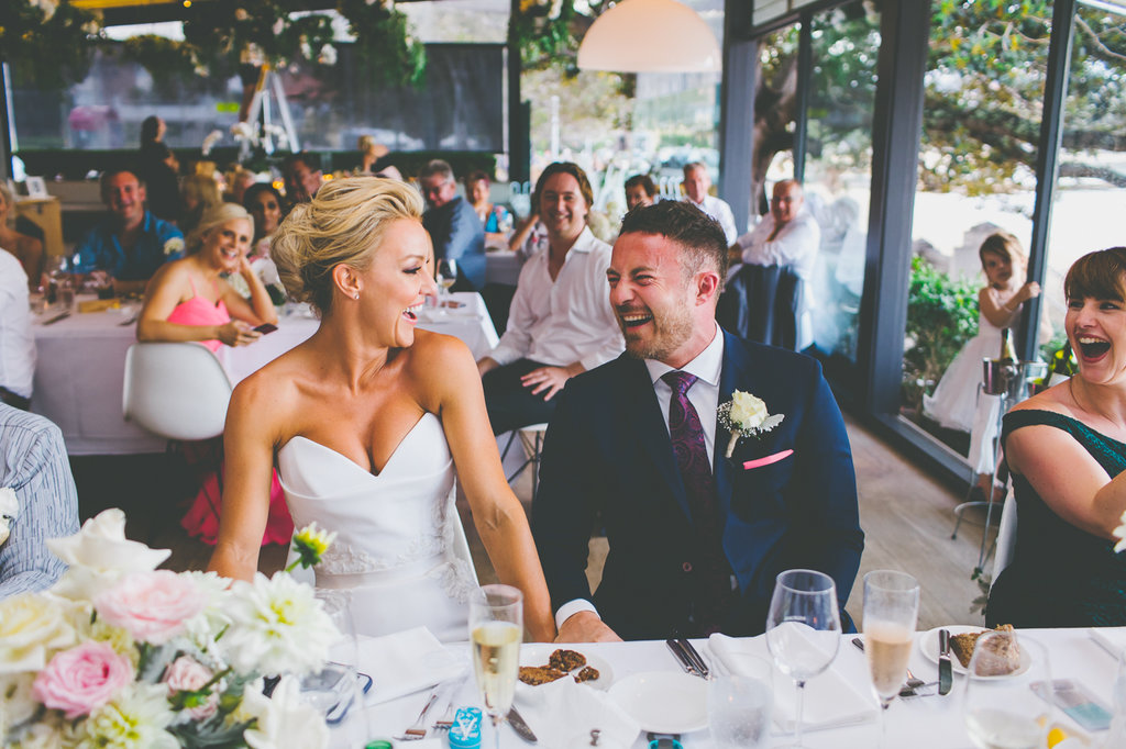 Bride and groom laughing at speeches at The Public Dining Room Balmoral Wedding Sydney