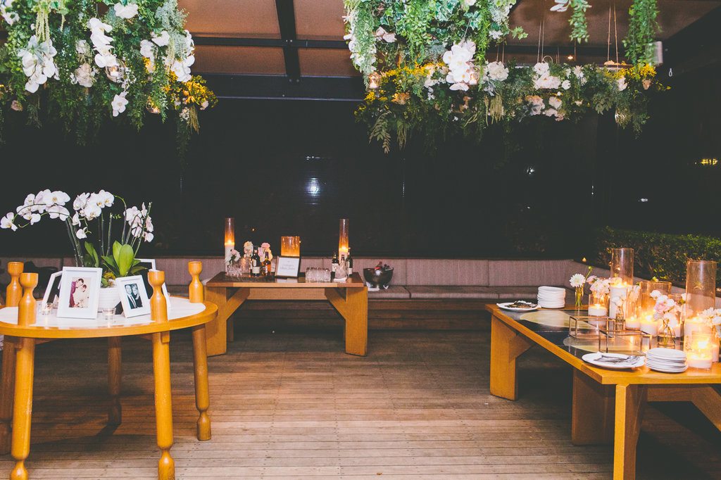 Hanging flowers, family photos and desert area at The Public Dining Room Balmoral Sydney Wedding Reception