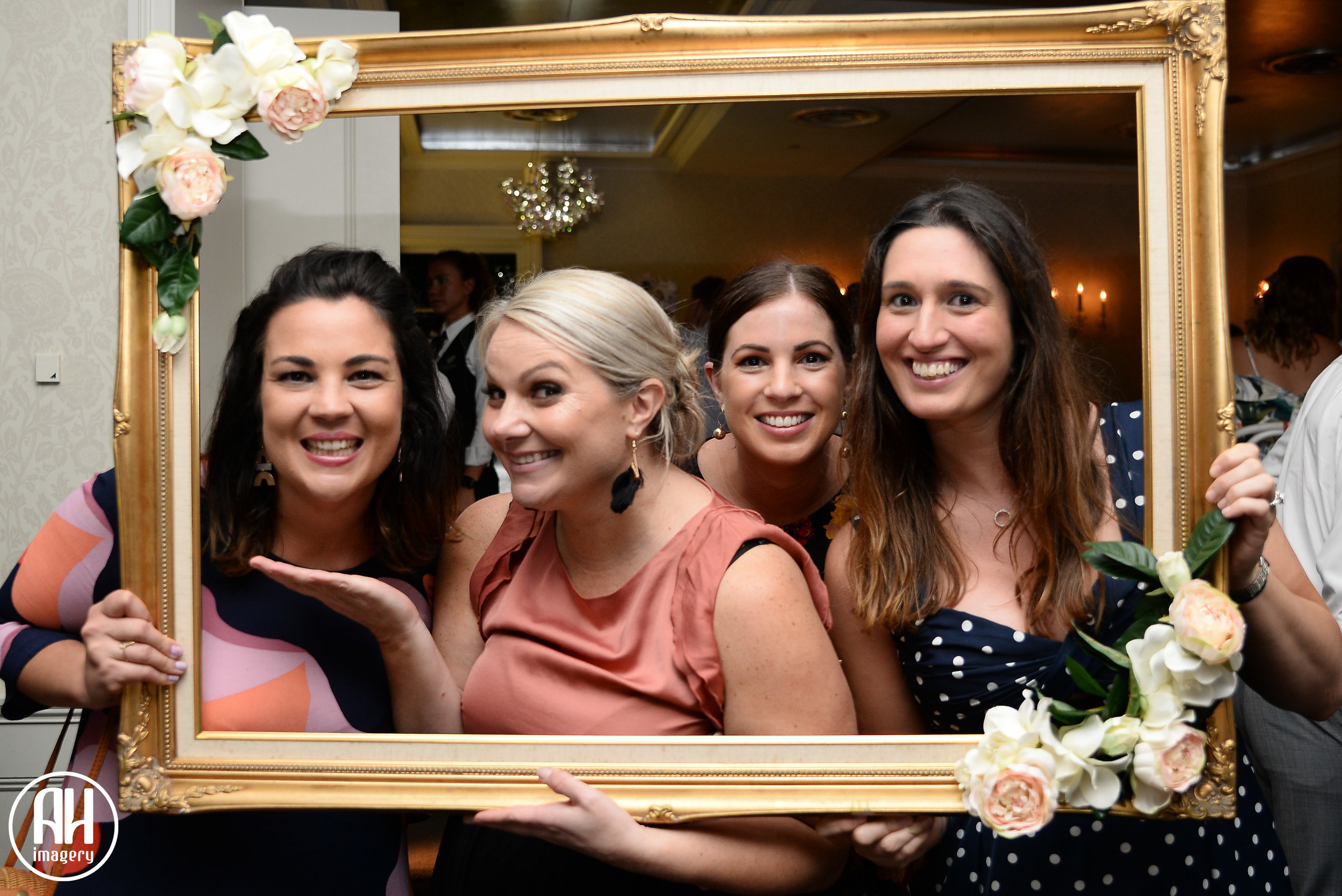 Wedding guests having fun at the photo booth at a Dunbar House Wedding Reception