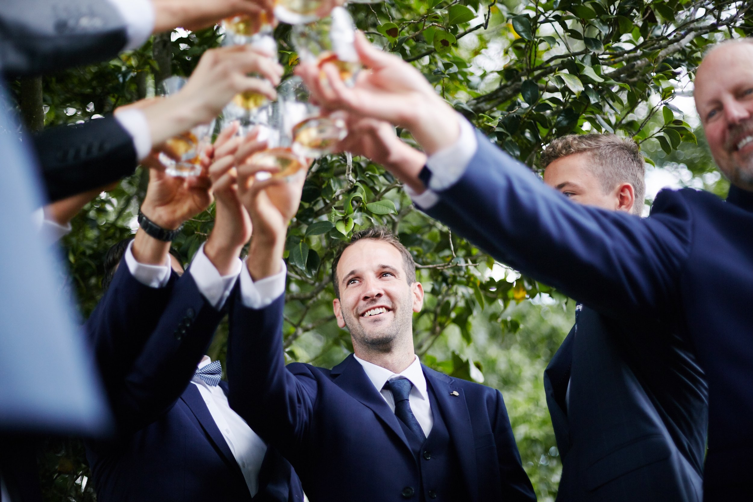 Grooms toasting drinks before the wedding starts