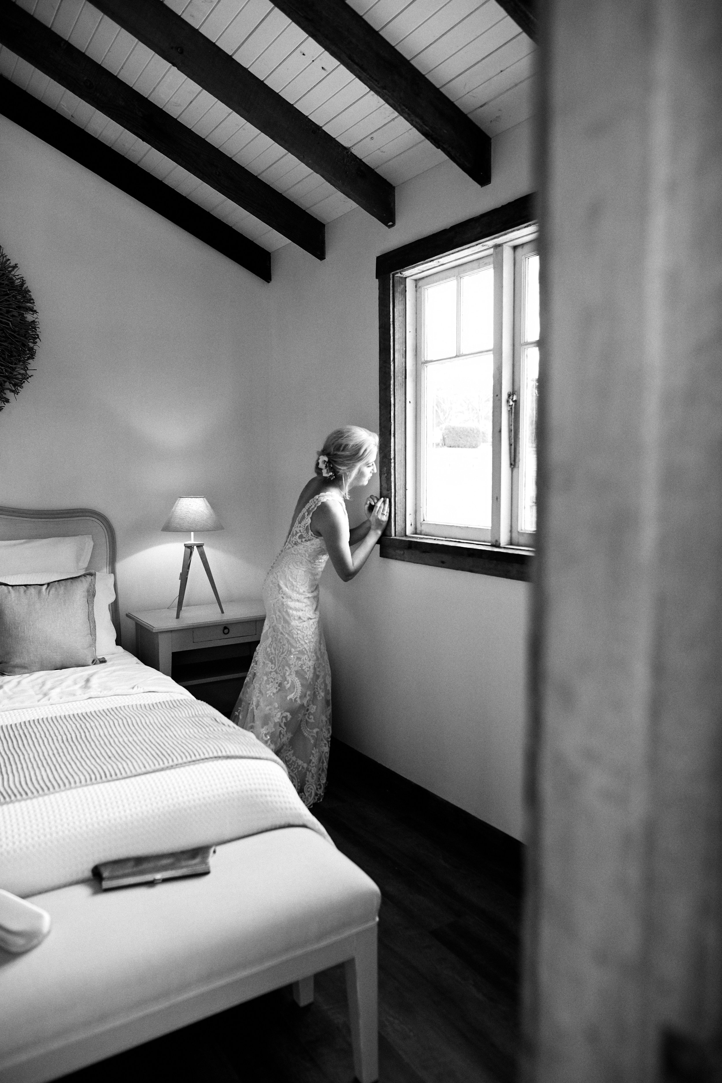 Bride looking out of a window before her wedding in NSW Central Coast