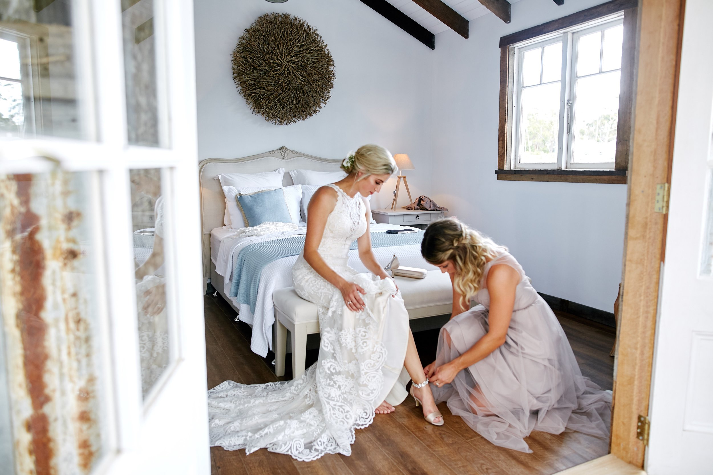 Bride putting on her wedding shoes.