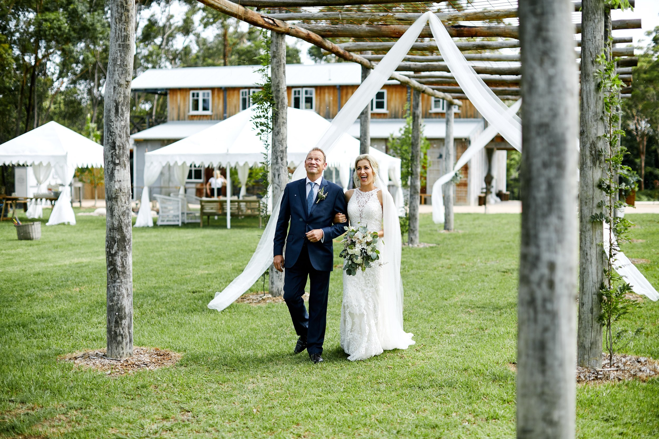 Bride and her father walking down the aisle at an outdoor wedding in NSW Central Coast Wedding venue The Stables of Somersby