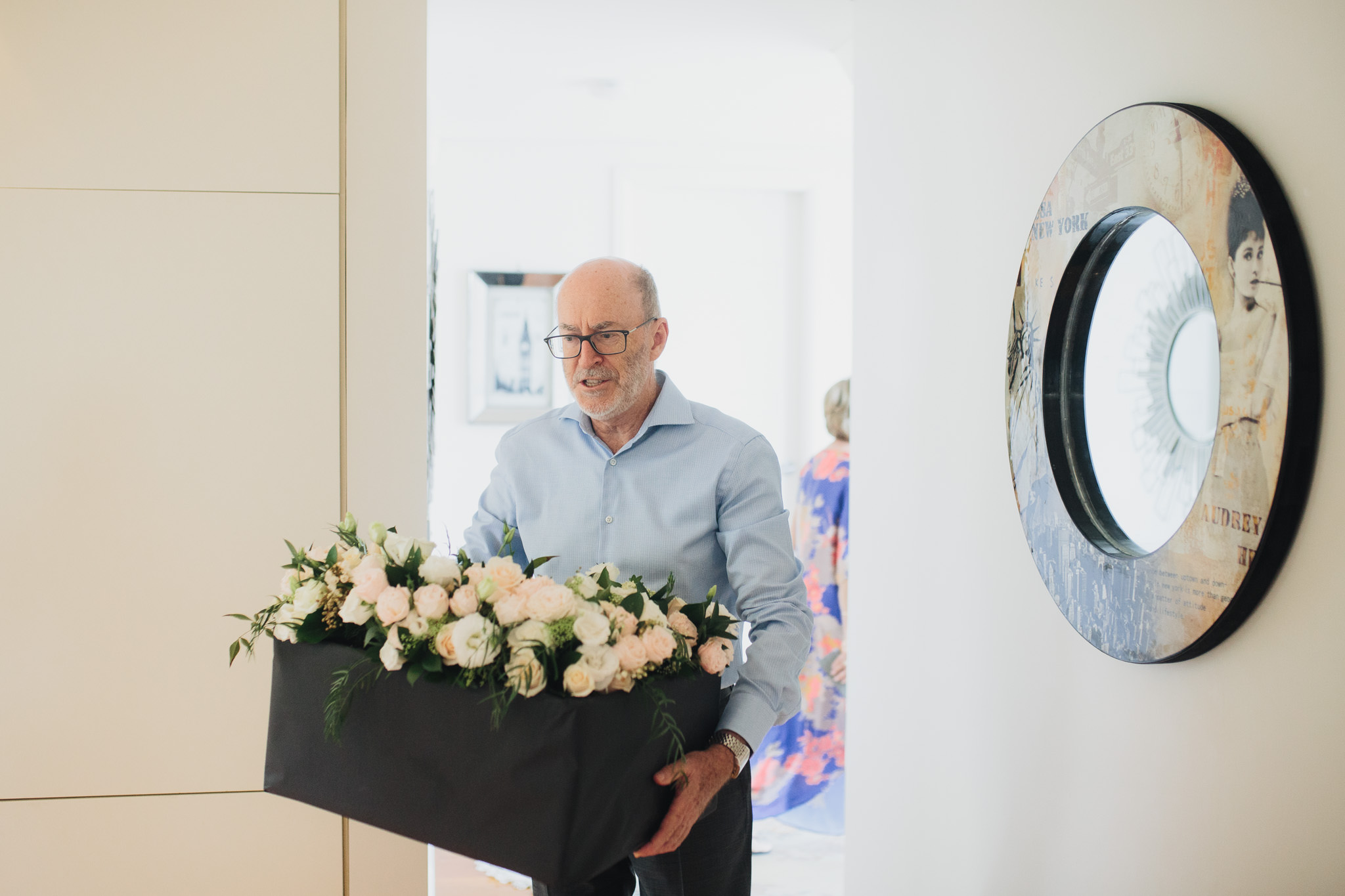 Father of the bride holding wedding flowers