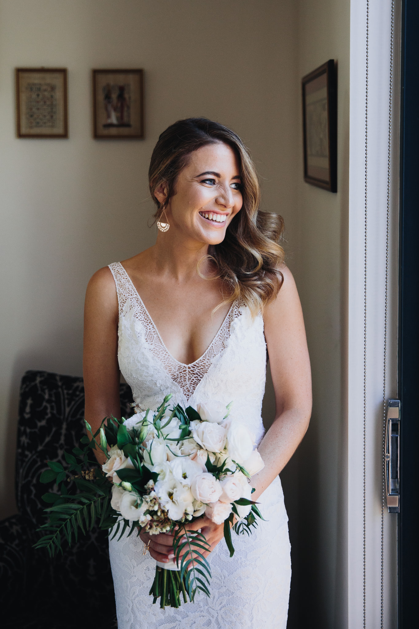 Bride wearing a Grace Loves Lace wedding dress holding her wedding flowers