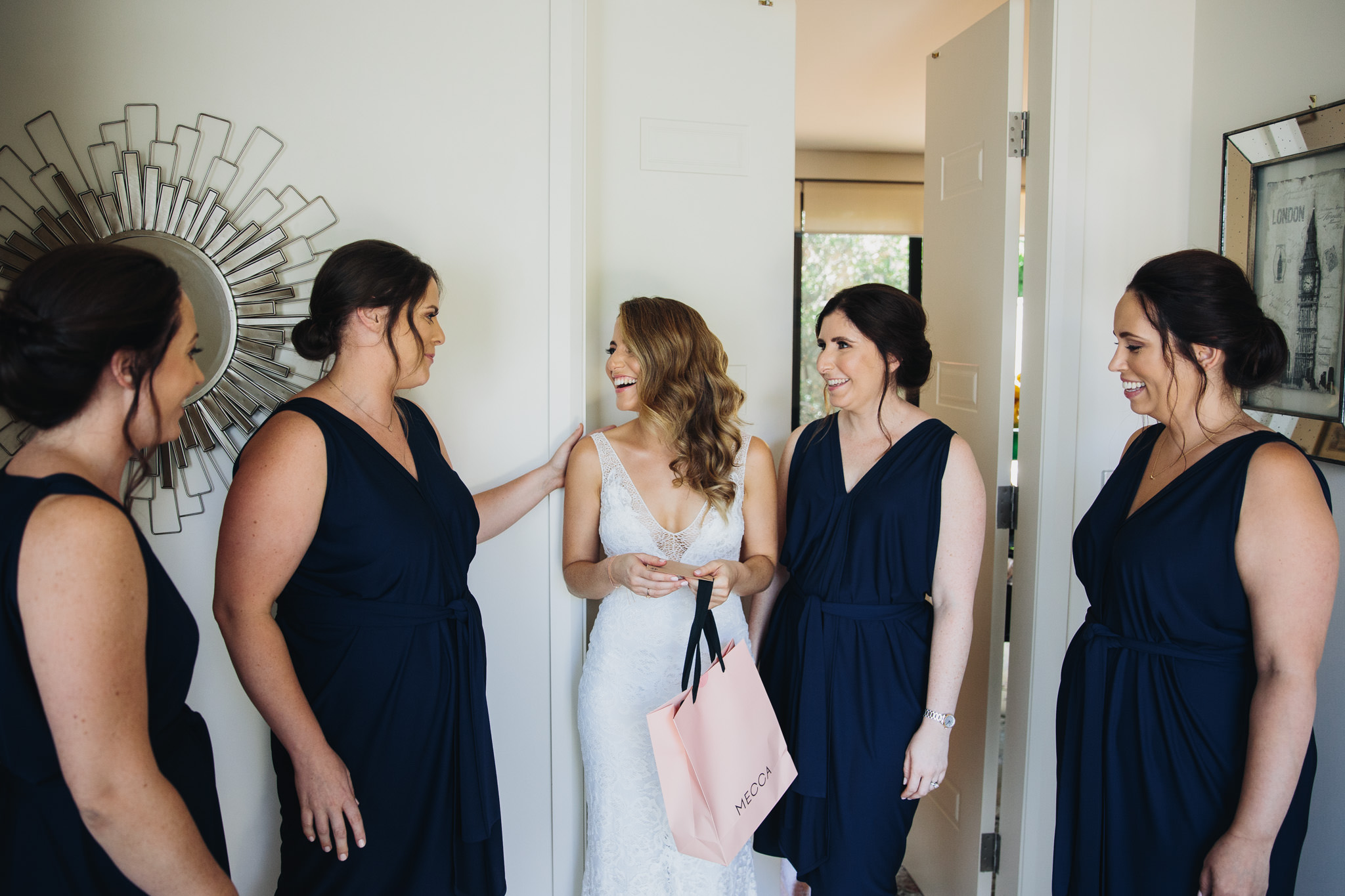 Bride and bridesmaids getting ready before the wedding