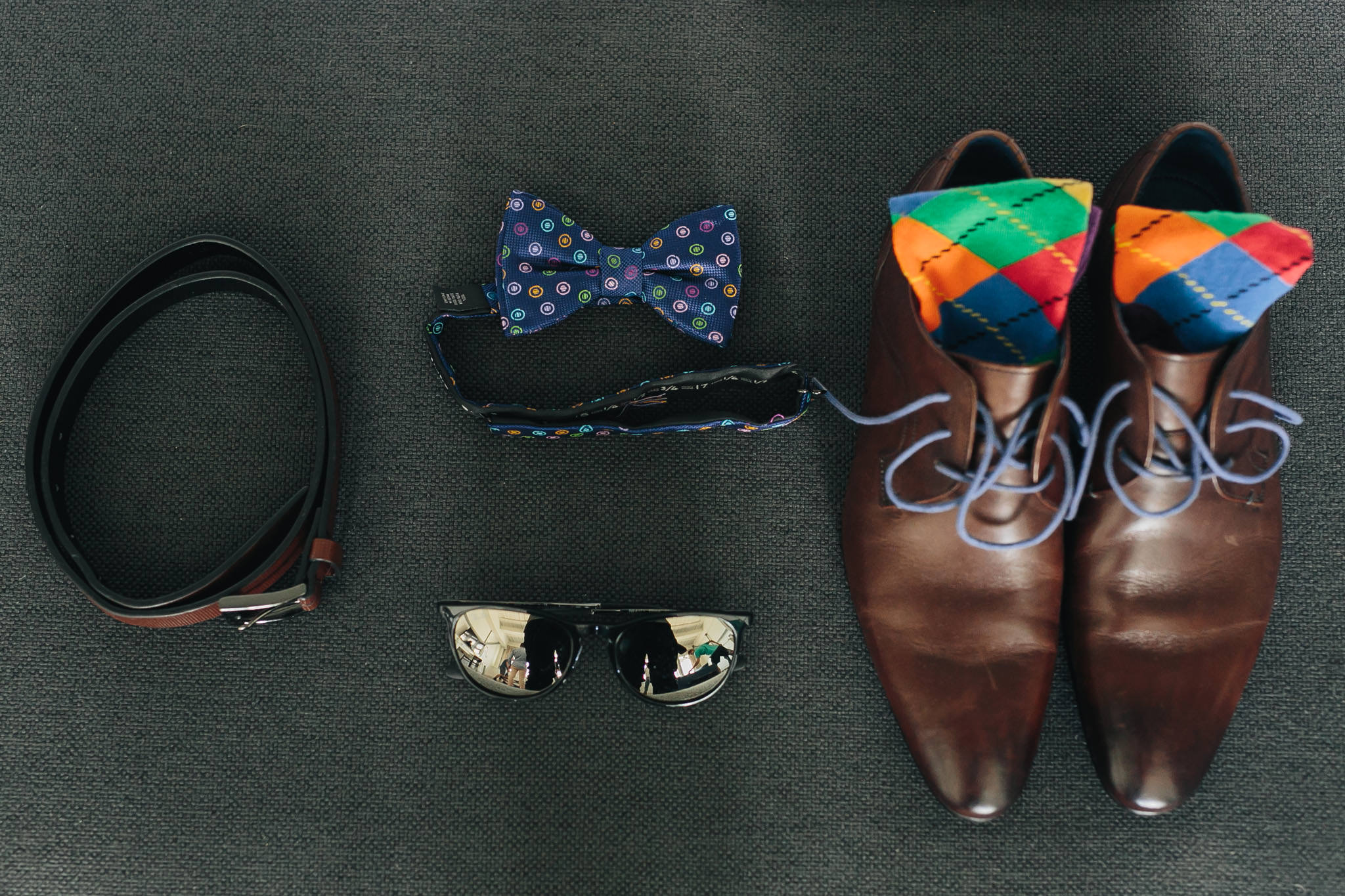 Grooms bow tie, shoes and accessories displayed for a wedding photo