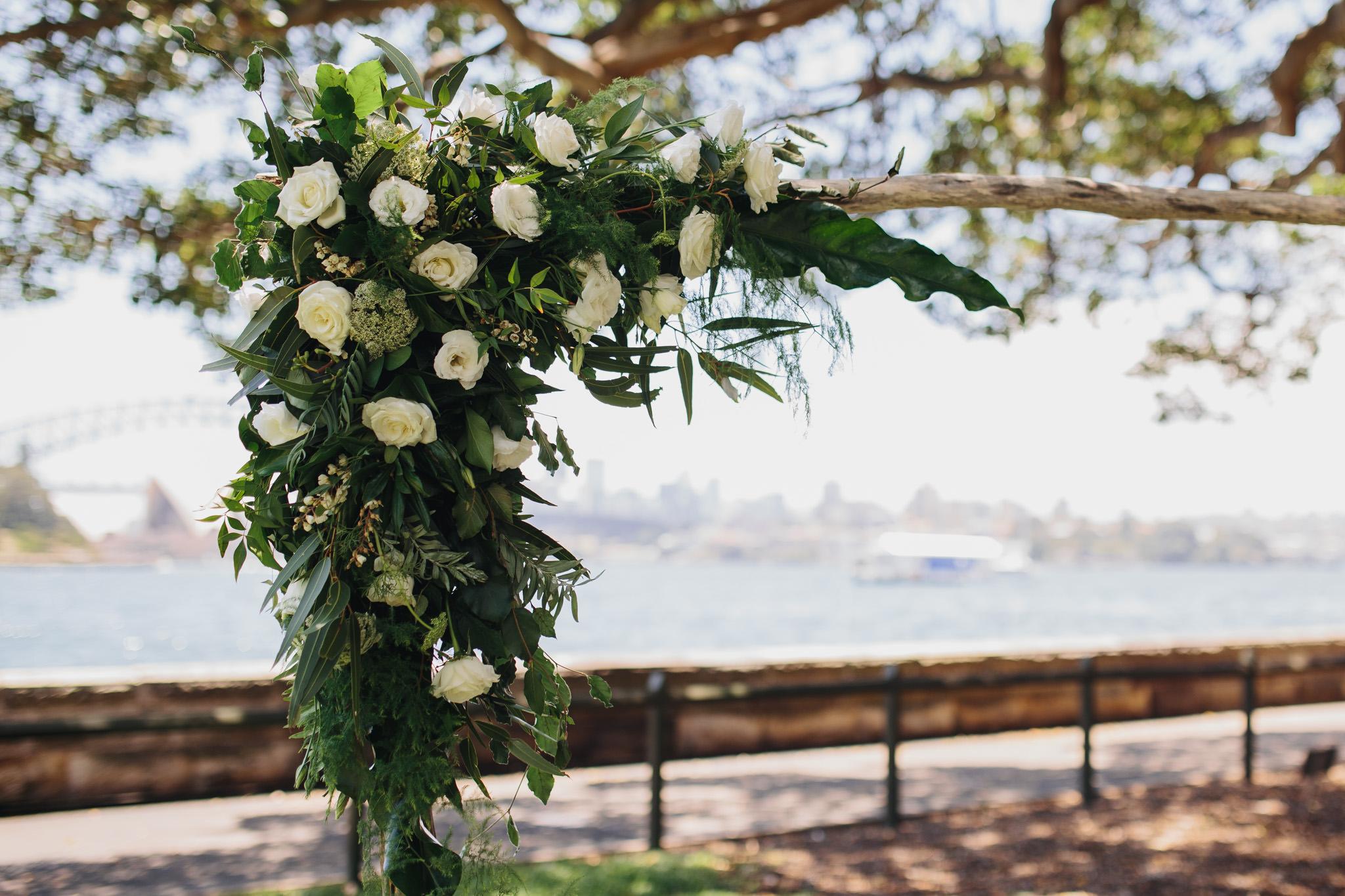 Wedding arch flowers at Sydney Botanic Garden wedding. Wedding on the Harbour View Lawn in Sydney