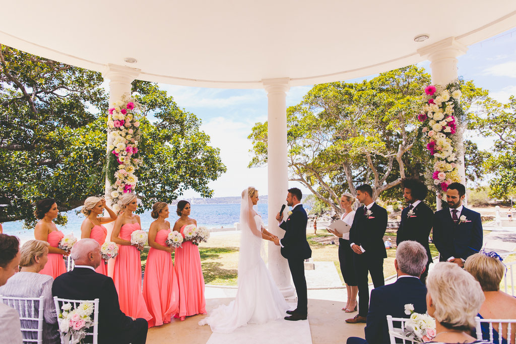 Wedding Ceremony with bride and groom walking down the aisle guests throwing confetti