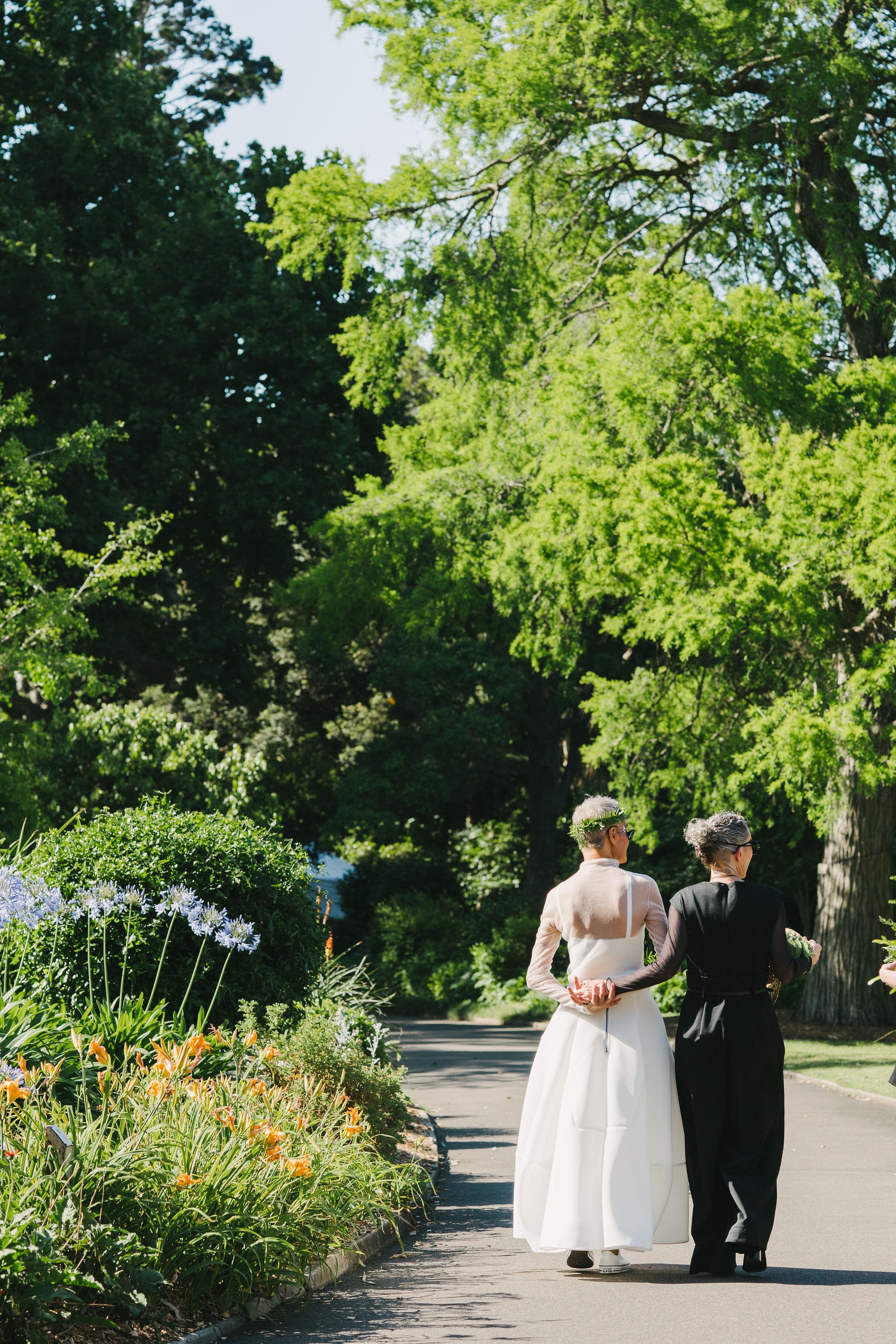 Brides walking through The Royal Botanic Garden Sydney for their wedding
