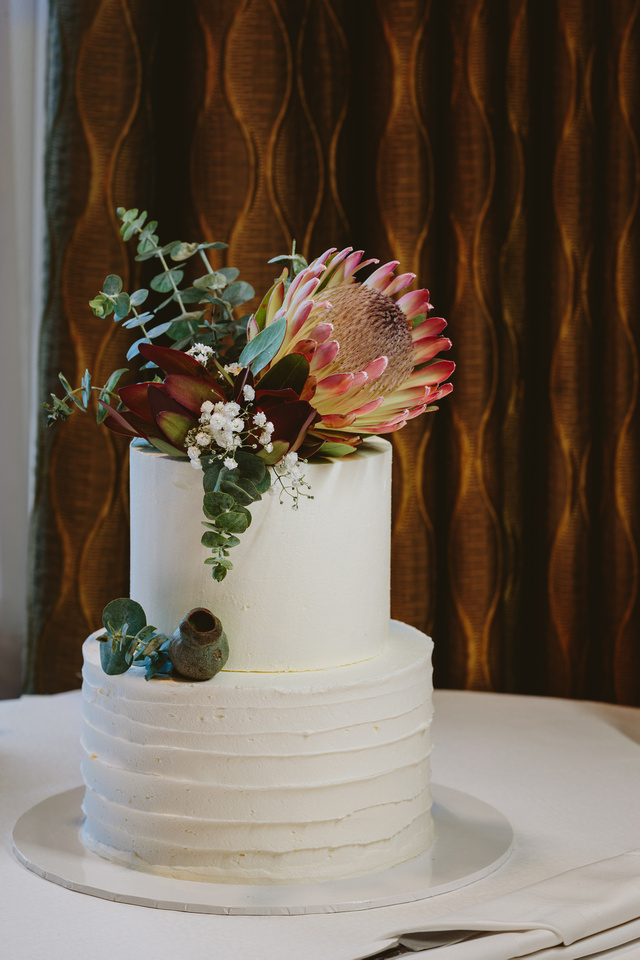 Wedding cake with native flowers and buttercream icing