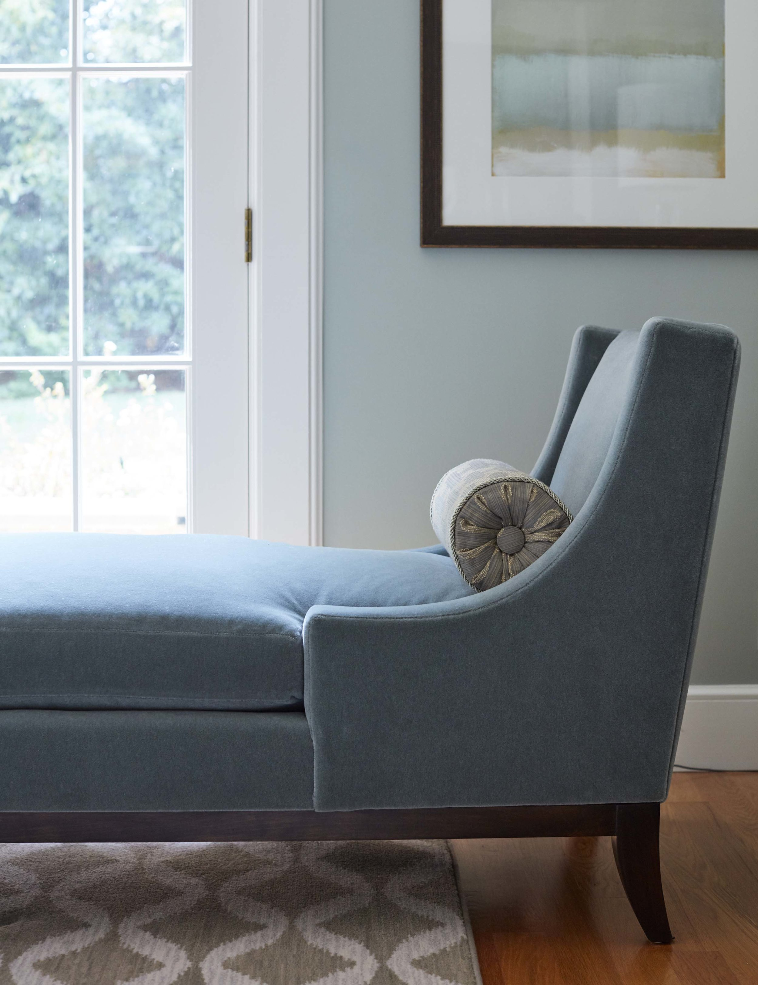 Who wouldn't want to stay and relax with a good book in this lovely blue-green chaise.