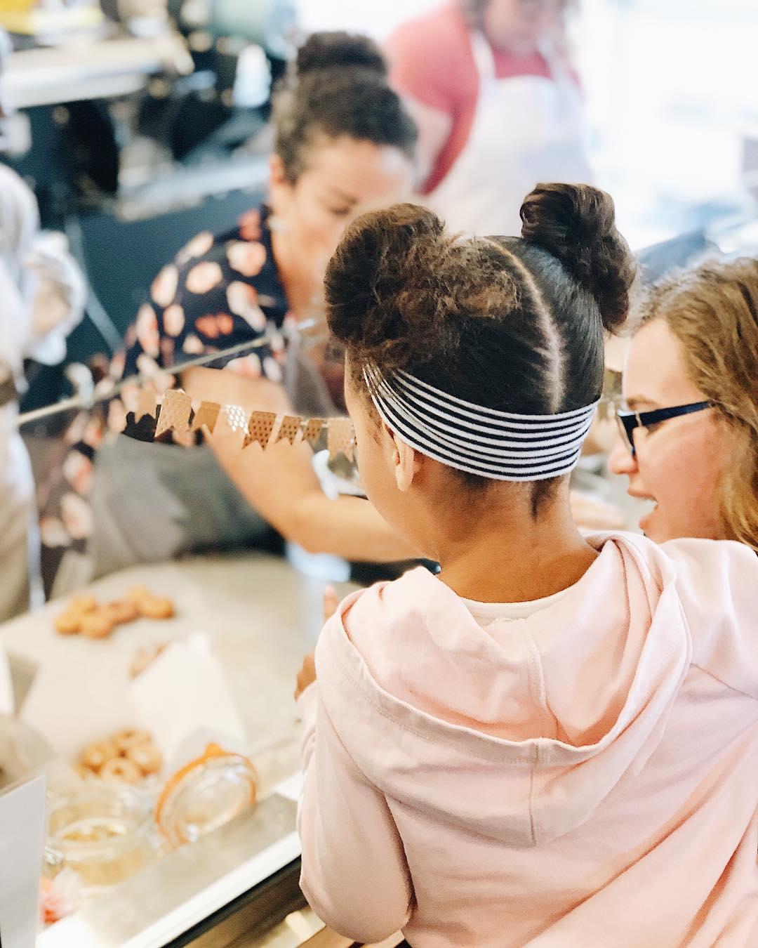 Customers watching donuts get made.jpg
