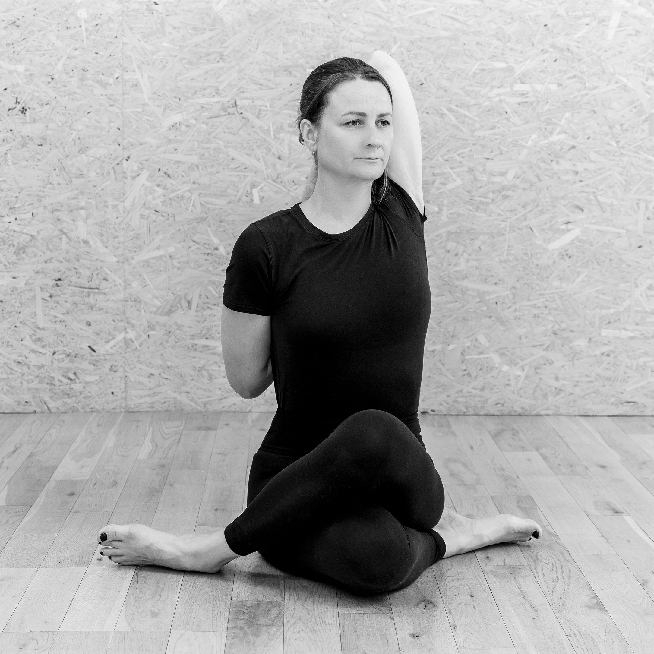 Alice Taylor-Rugman Private corporate yoga classes in London gomukhasana pose