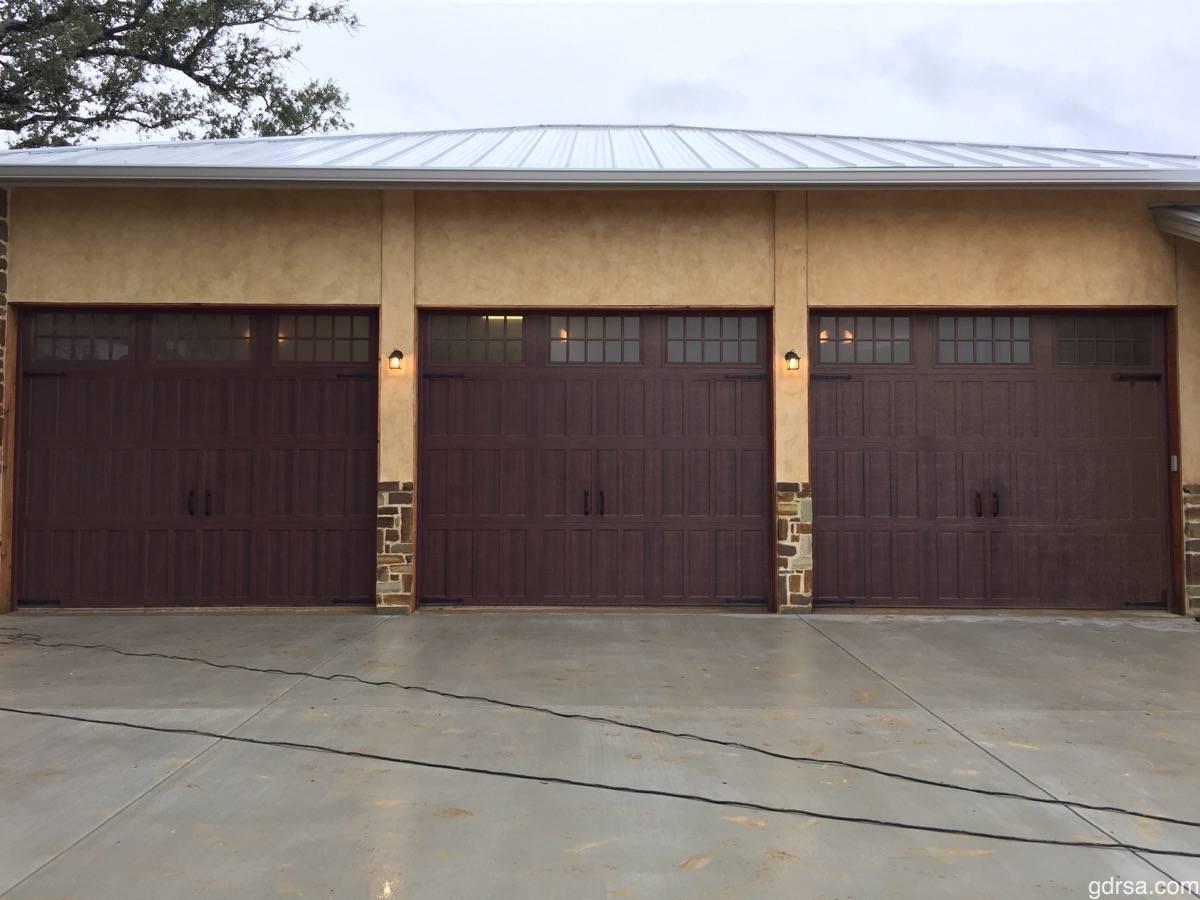 Size: 12x10   Collection: Amarr Classica 3000   Color: Mahogany Woodgrain   Style: Northampton    Windows: Clear Glaze    Window Inserts: Madeira    Decorative Hardware: Cantebury