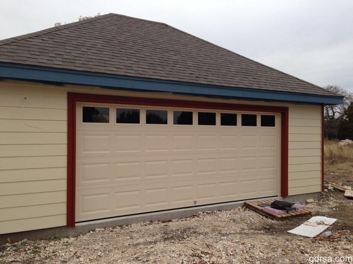 """Size:  16'x6'9""""  Collection: Amarr Stratford  Color: Almond  Style: Short Panel   Windows: Short Panel"""