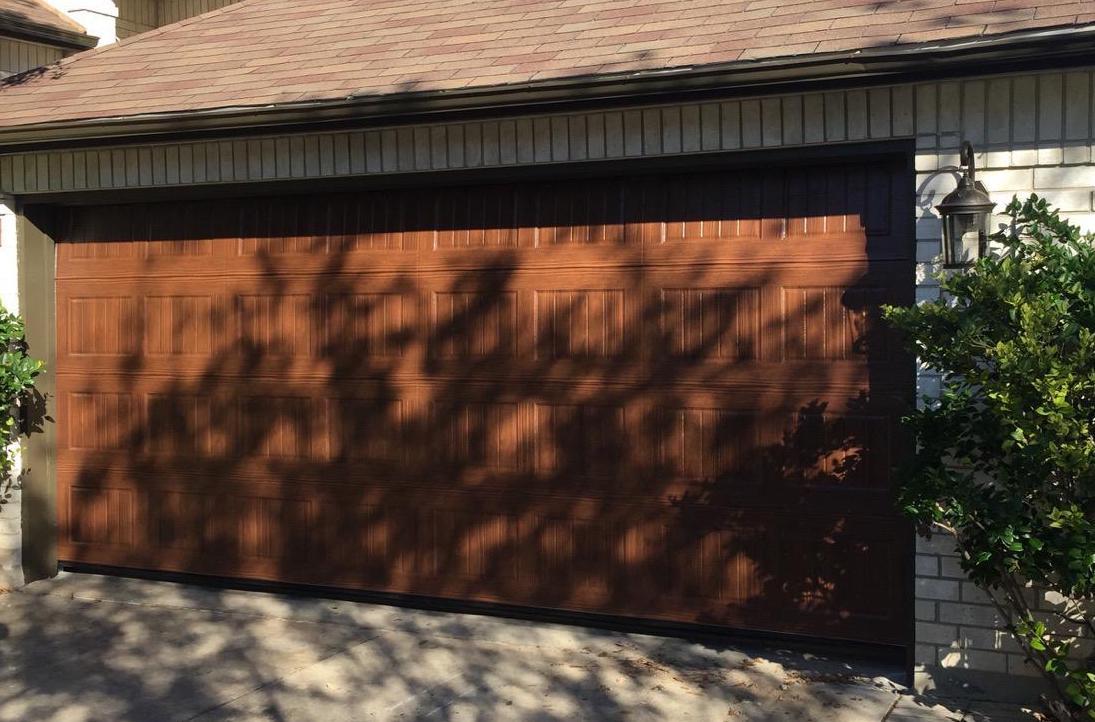Size: 16x7  Collection: Amarr Oak Summit   Color: Walnut   Style: Bead Board   Windows:  Long Panel Thames    Decorative Hardware: Castle Rock Magnetic Handles