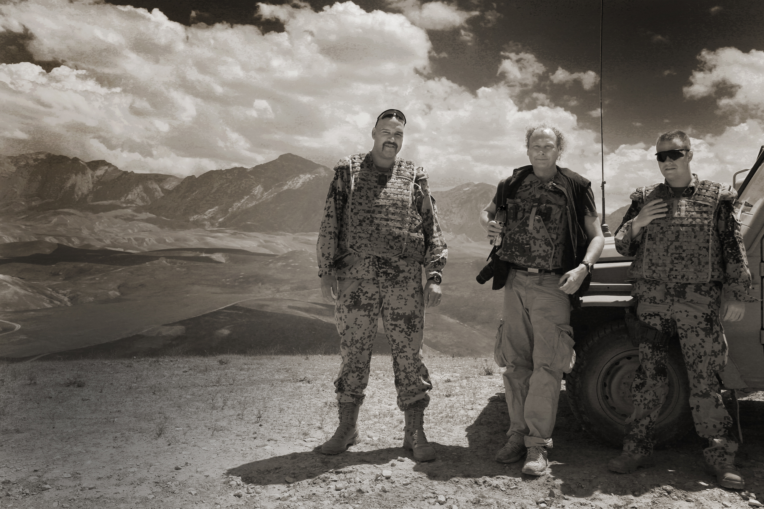 Bazar - e-Sharif / Afghanistan / 2009 :  Silk Road Operations in the north western region of Afghanistan, Per Fronth seen here in the filed with German security forces. And in his studio with his large commission for the Norwegian Intelligence Service HQ. One of their officers died in a IDF - attack en route from Mamare. Only the broken glass of his windshield remained.