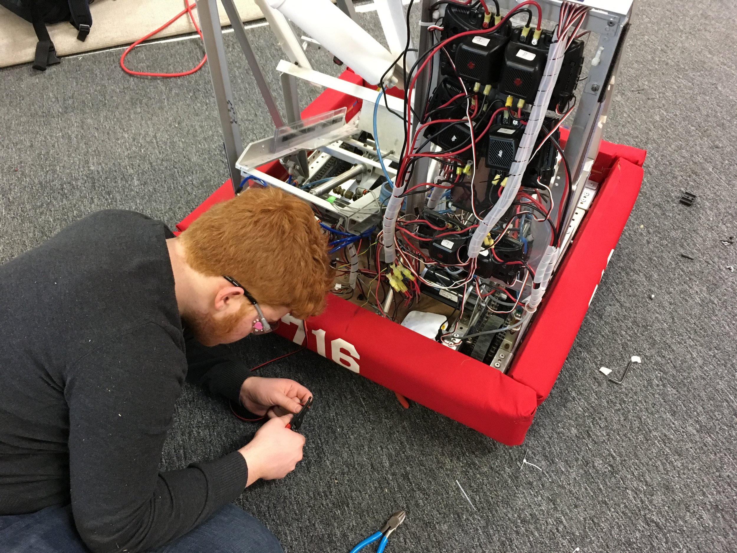 While our robot is being built, the programmers need a robot on which to test their code. One of our older robots is updated with current tech to serve as a test bed until the build team completes the competition robot.