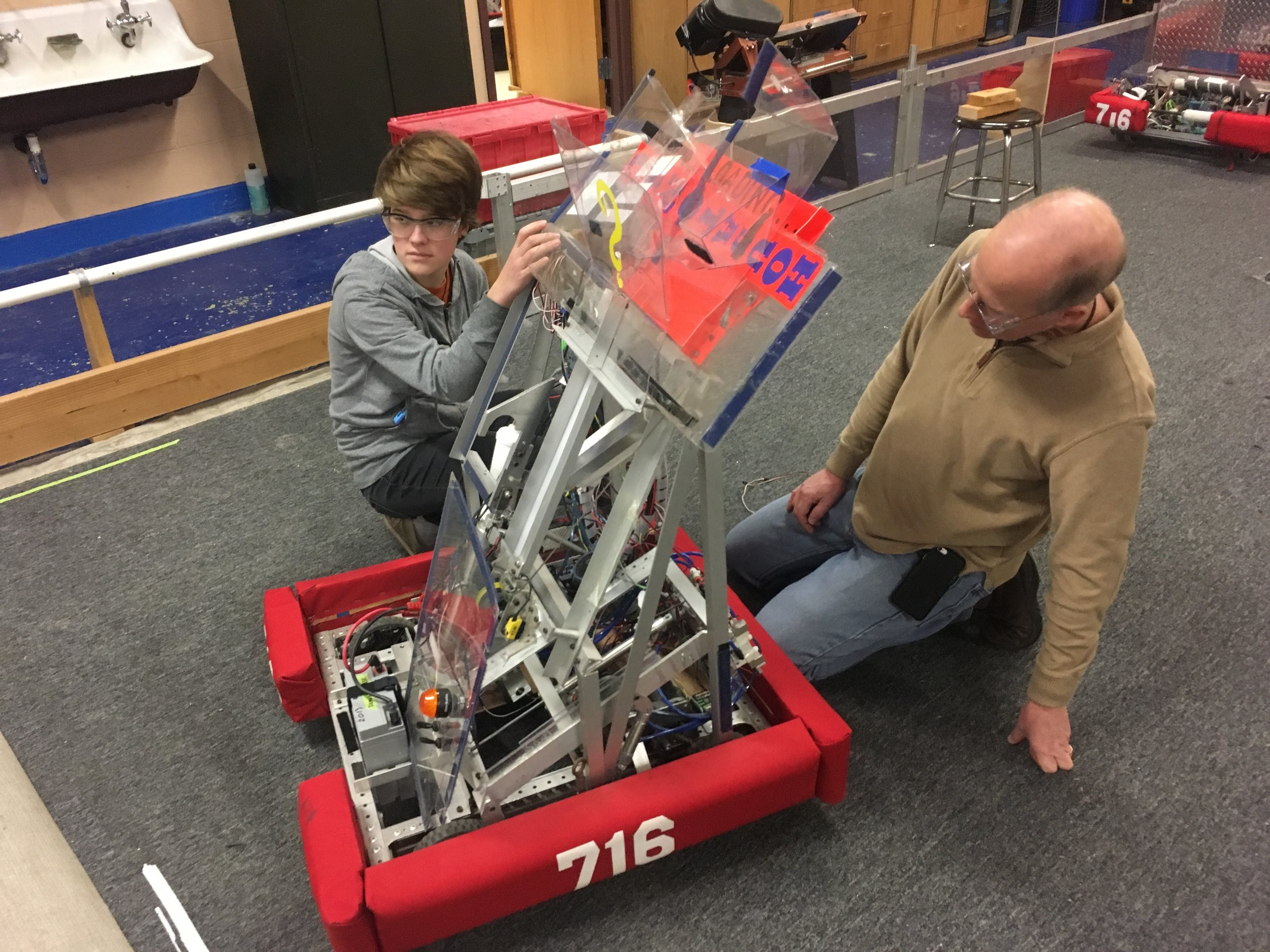 Part of our programming team, rewiring the test robot.