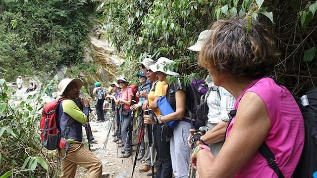 Travelers taking a water break. Hiking to Choquequirao is one of the most challenging trails in Peru.
