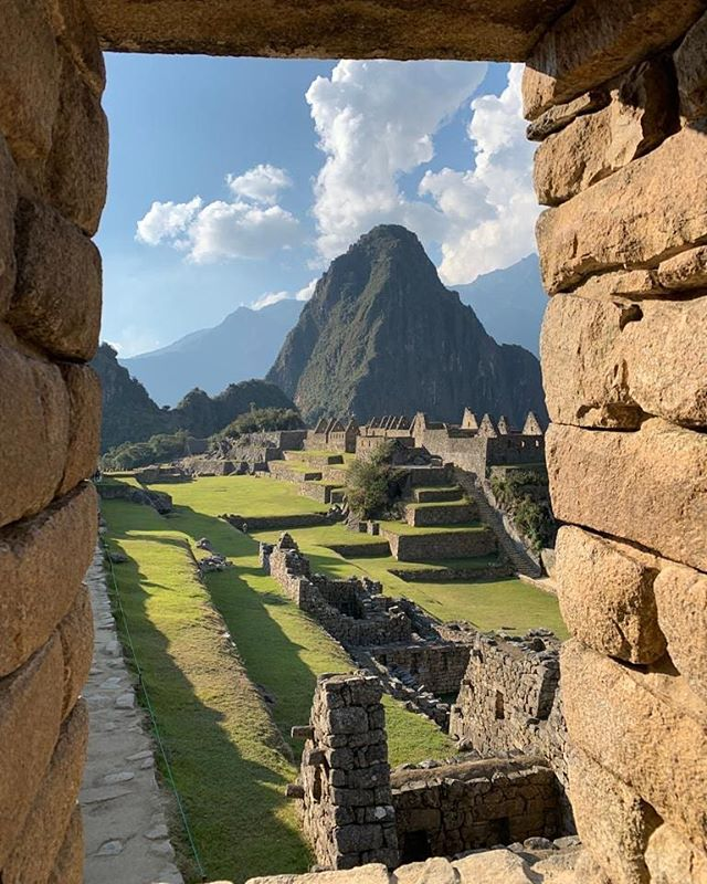 Hey there Huayna Picchu!  The sunrise light highlighting the trail to the top, 1000 ft gain in 45 minutes (avg). It's so steep, and narrow, that only 400 hikers are allowed per day, using cables and railings for support.  Promise, the view and challenge are very worth it.