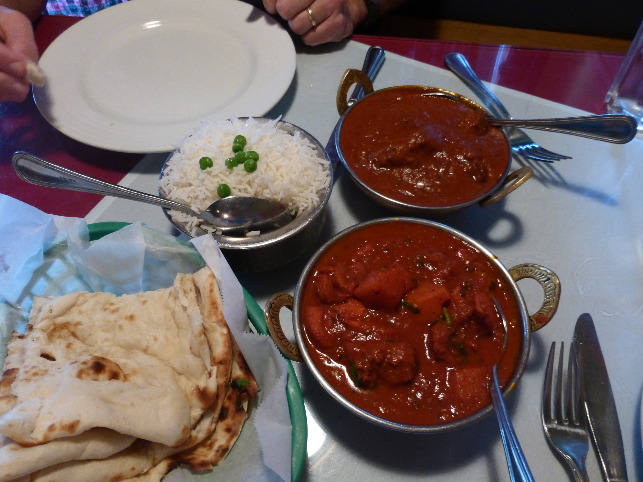 I should have written down what these dishes are called. Chicken with vegetables in a sauce. Served with naan bread or steamed rice. Yummy!