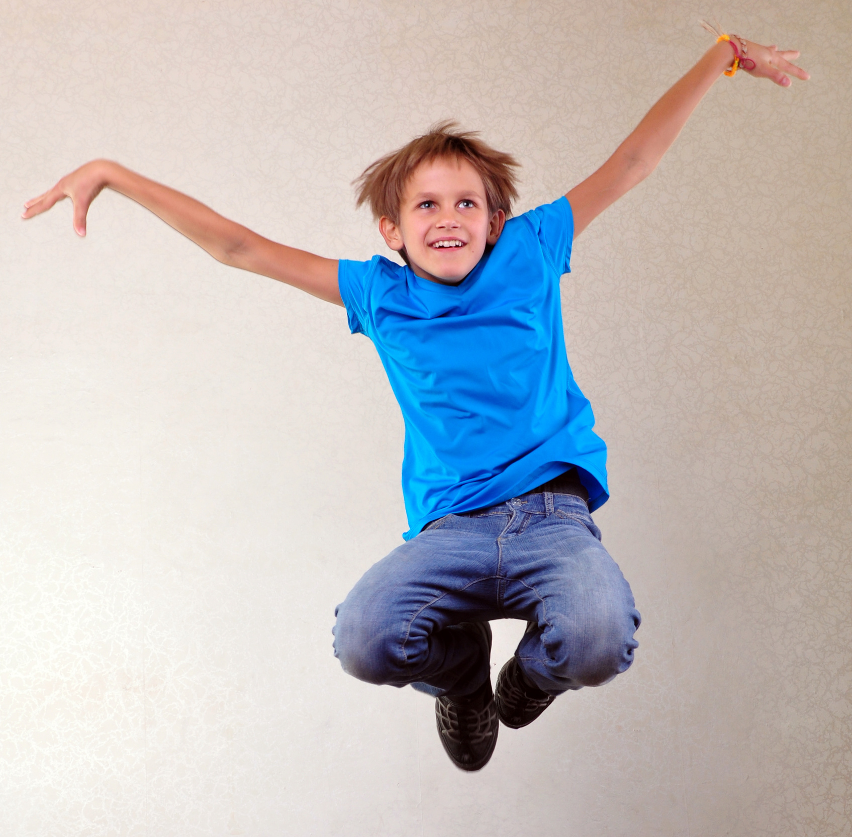 047504769-portrait-child-jumping-and-dan.jpeg