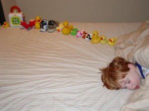 Autistic-sweetiepie-boy-with-ducksinarow-300x224.jpg
