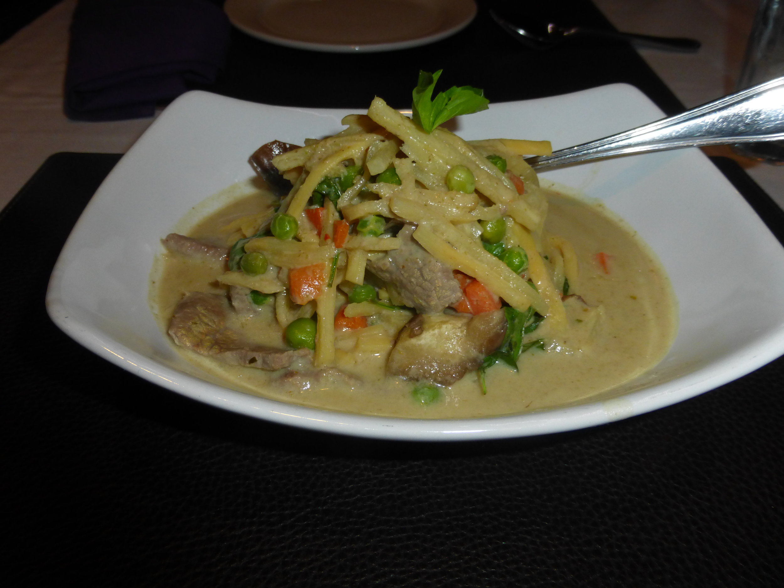 Our friend ordered  Thai Green Curry  with beef, coconut milk, bamboo, peas, carrots, eggplant, and sweet basil.