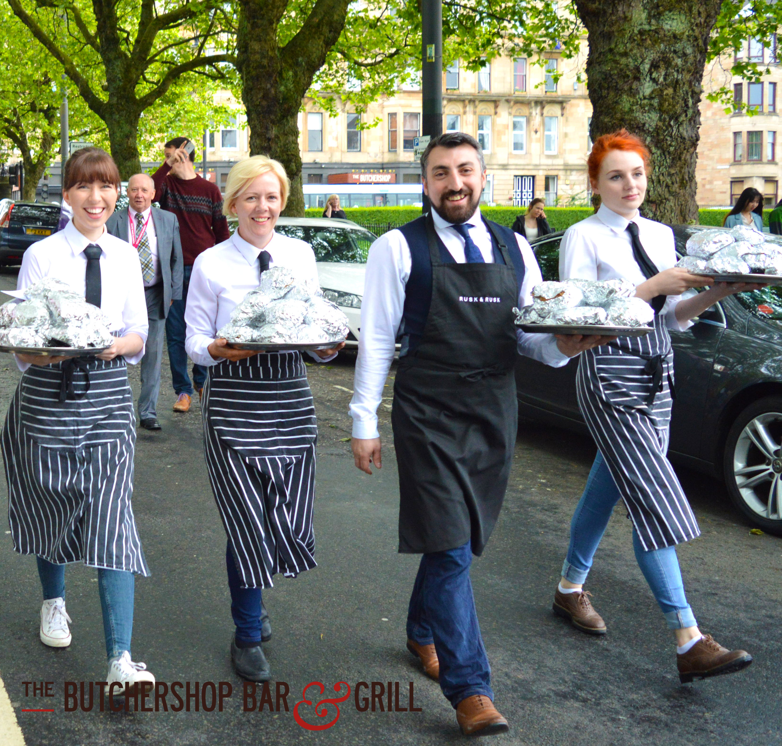 Manager Chris Kelly leading his team from The Butchershop, rolls in hand.