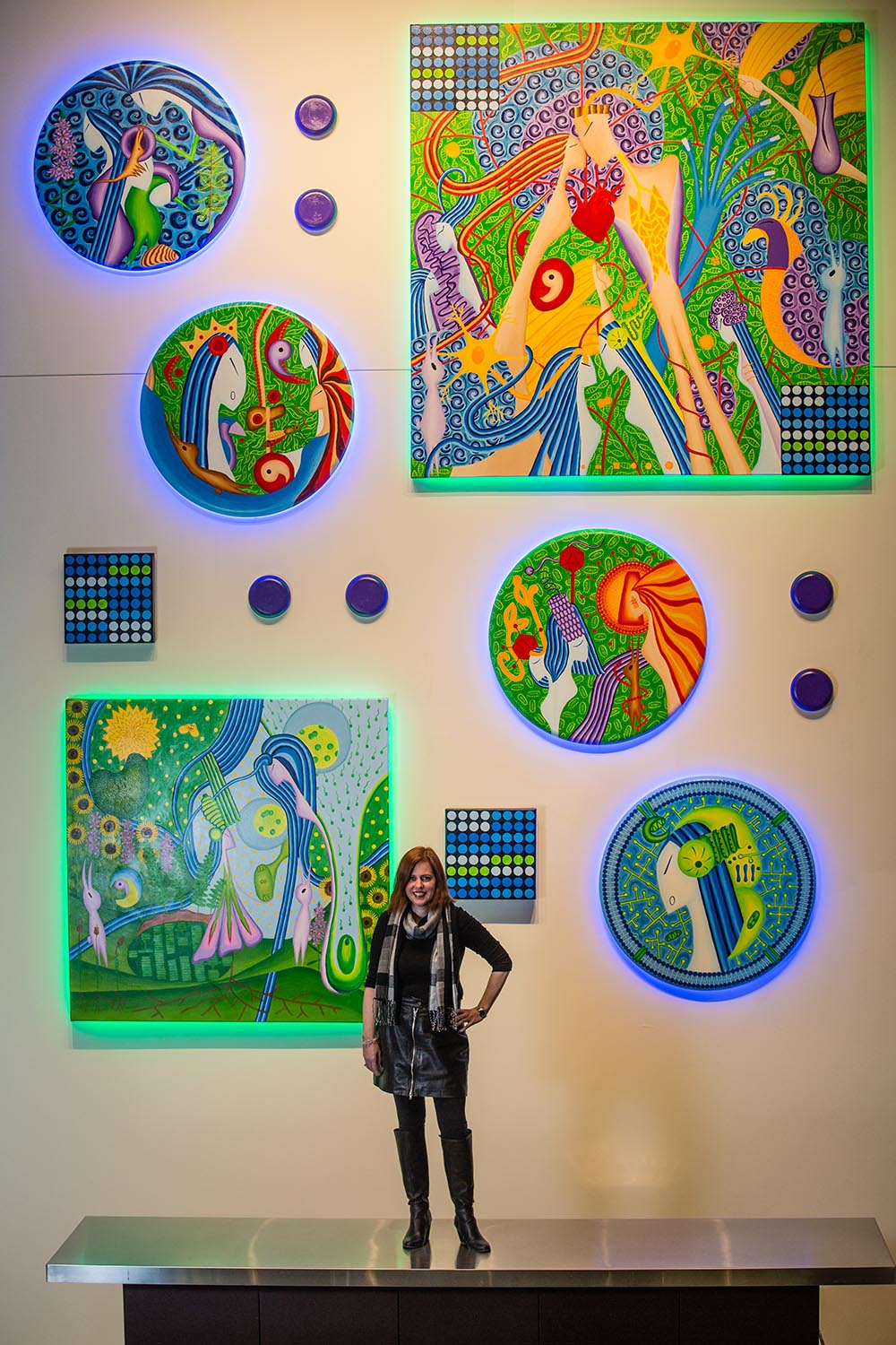 """""""Life Evolves,"""" 14 oil paintings and LED lights, 15' x 13'"""
