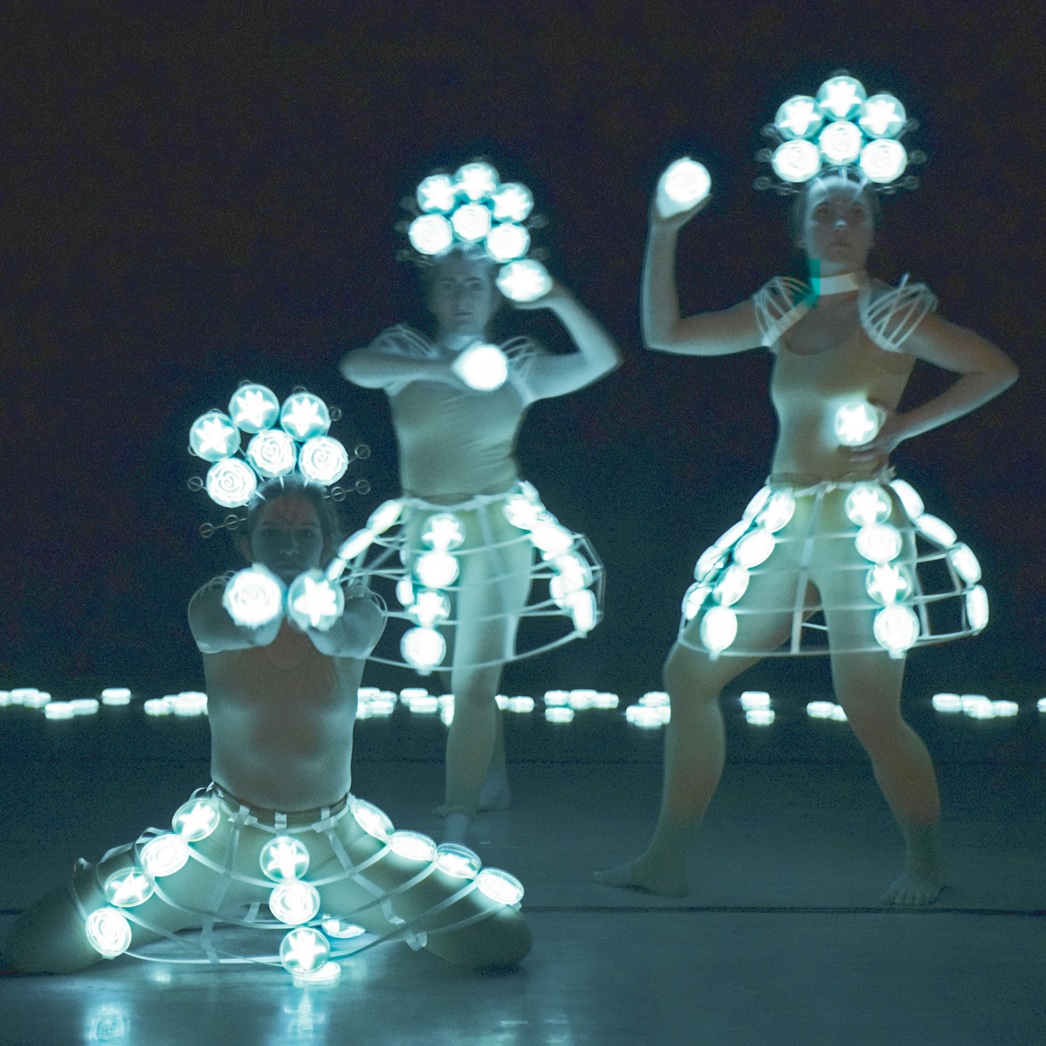 """Dancing Trio,"" photograph by the light of bioluminescent bacteria, Hunter Cole."