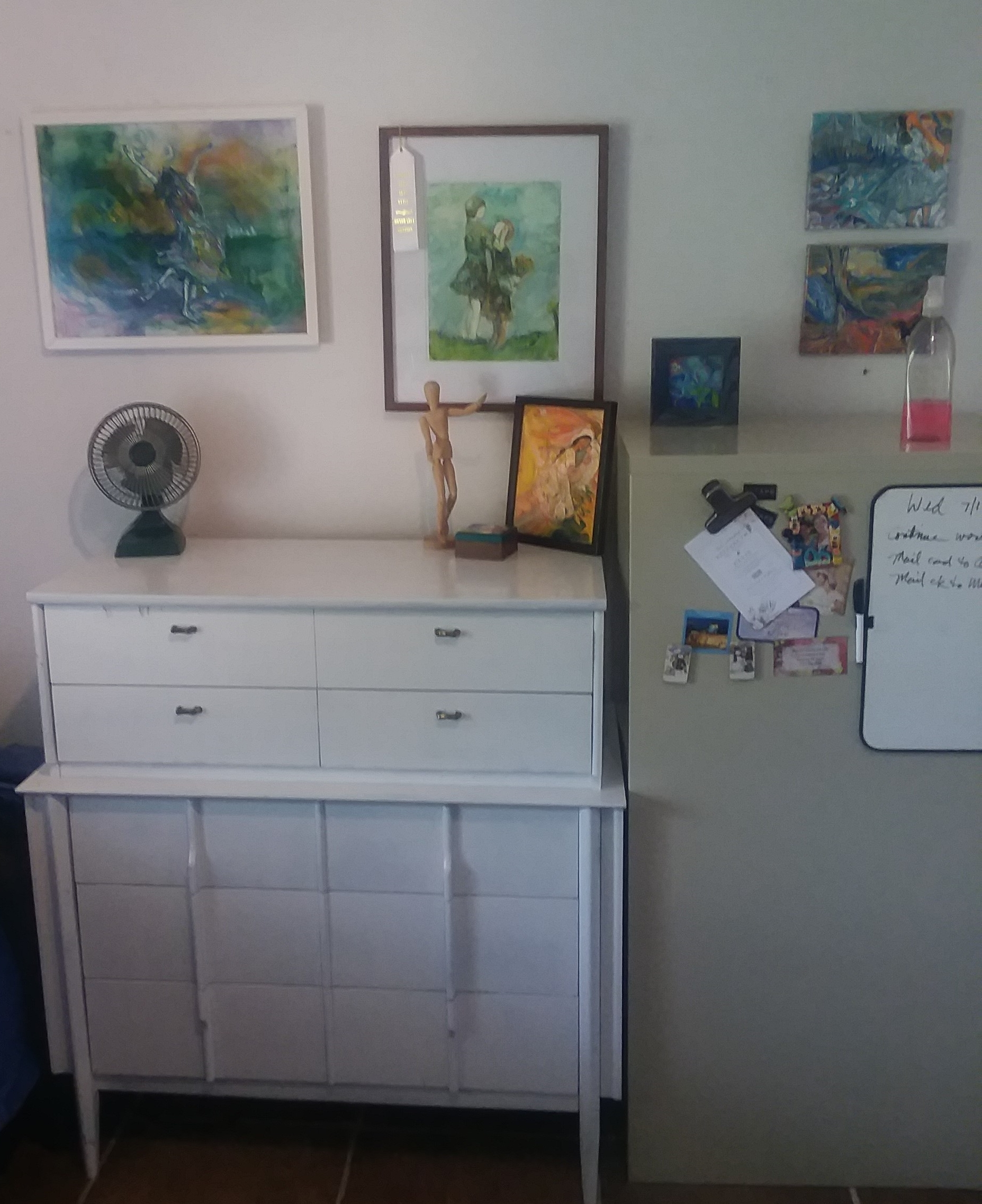 The dresser was purchased for $6 at a local thrift store and painted white. I now keep prints, and unframed paintings there along with a few other items.