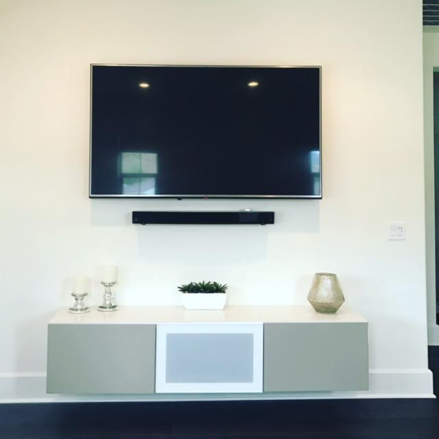 Here we hung the TV, Sound-bar and floating cabinet.
