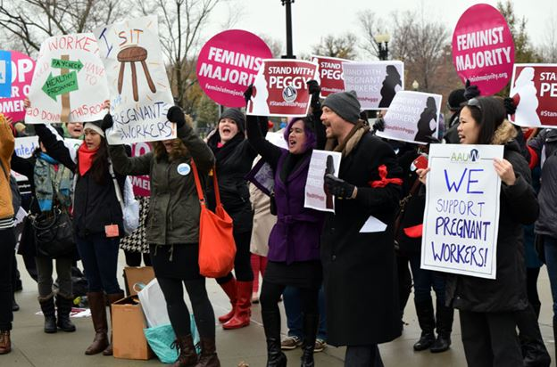 Protesters outside the Supreme Court in Washington D.C. in December 2014 rallying around Peggy Young, a UPS worker who was fired for being pregnant.