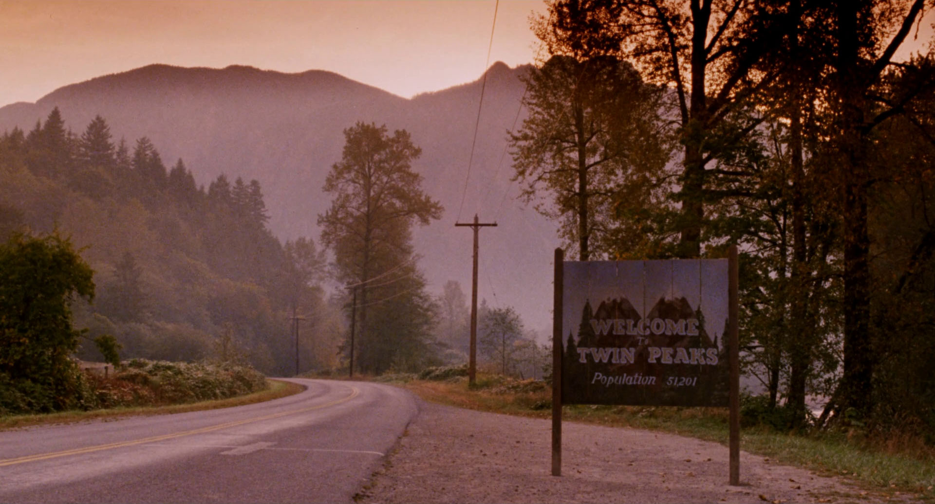 "Now that you've made it through some of David's films I'm gonna go ahead and leave you with one of his more ""mainstream"" contributions. Twin Peaks has pretty much influenced any slightly surreal show you see on TV today like Black Mirror, Atlanta, and the X-Files. It's with Twin Peaks that Lynch allows you the furthest in depth look at the characters he usually only presents to you for 2 hours. This connection you build with the citizens of Twin Peaks lets David manipulate you on an even deeper, personal level and for first time Lynch viewers, it hits home hard. I'd probably like to recommend this at the top of the Lynch journey, but seeing as it's a full-on show and not a film I figure it's best to leave it here with you at the end, because after Twin Peaks you'll pretty much be up for to watch anything David has his name attached to, if you're not already. Twin Peaks is about the murder of a homecoming queen in a small Pacific Northwestern town called Twin Peaks. It's here where FBI Agent Dale Cooper discovers that there's much more to the small town of Twin Peaks than meets the eye. It originally aired in the early 90's and in case you've been living under a rock for the last 2 years, they came back for a return season last summer!"