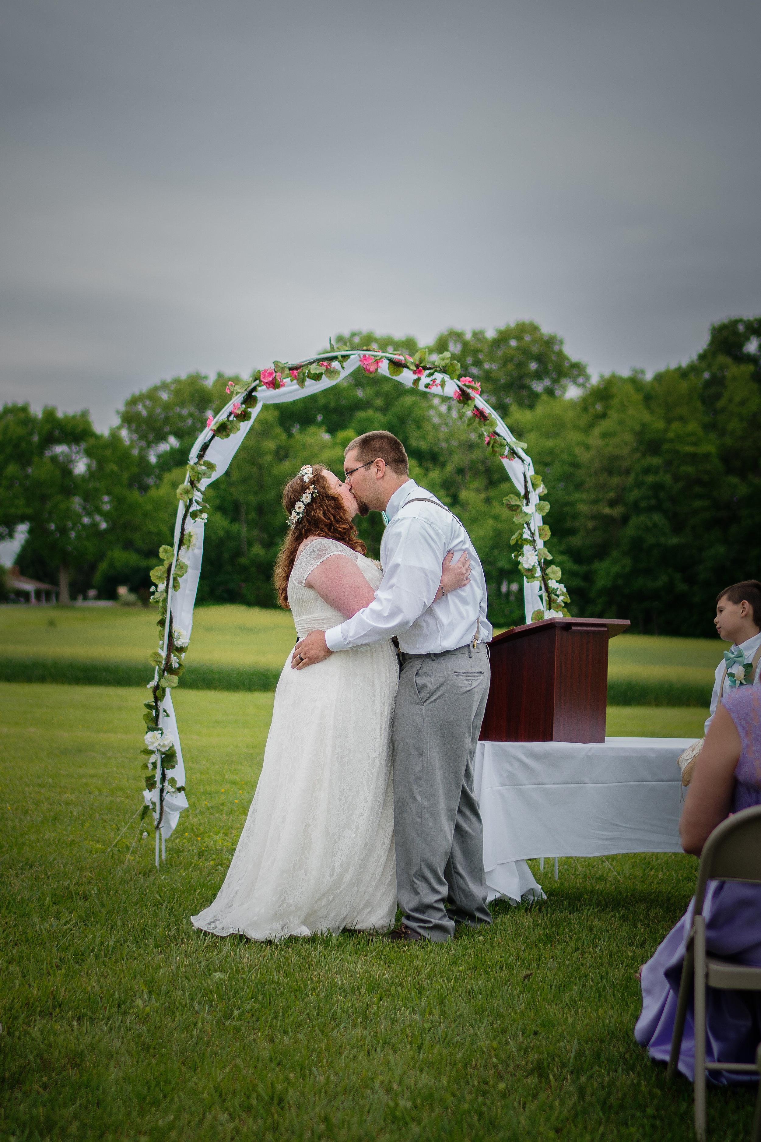 wedding first kiss photo