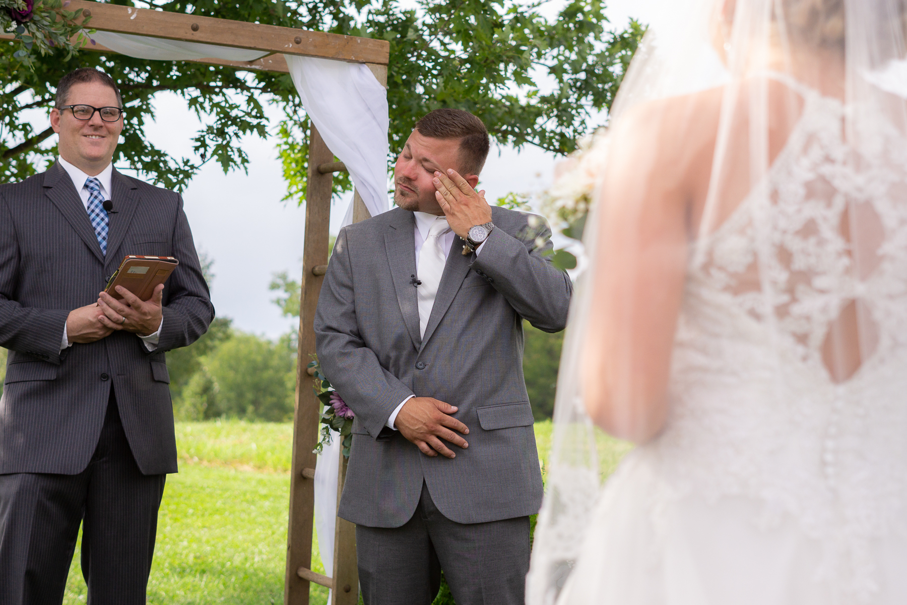 Groom reacting to seeing his beautiful bride for the first time while walking down the aisle