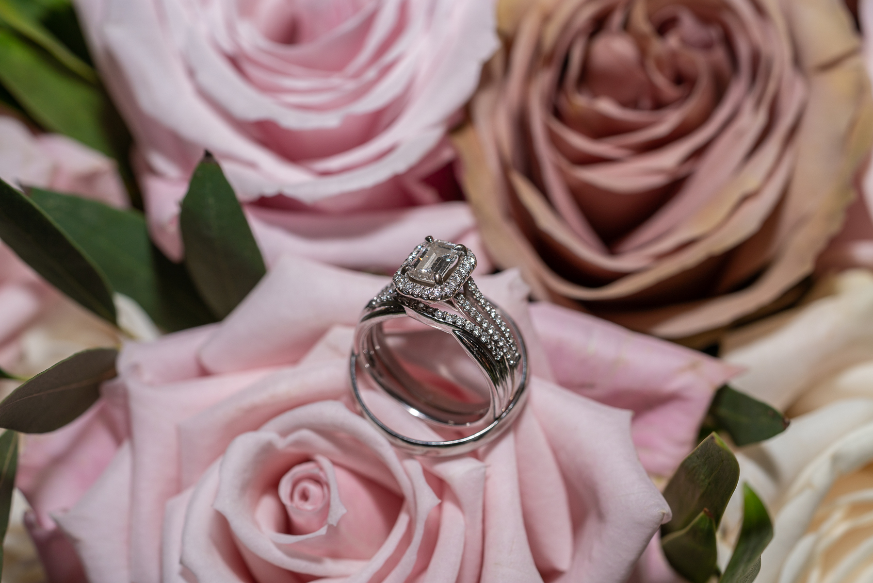 The rings nestled on the Bride's bouquet.