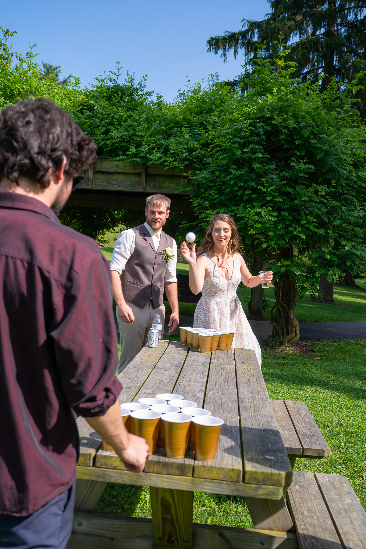 The Newlyweds partaking in the outdoor games during Cocktail Hour…yes, that's Beer Pong!